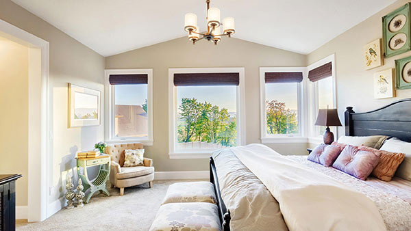 Clean and refreshing bedroom with windows for Feng Shui home