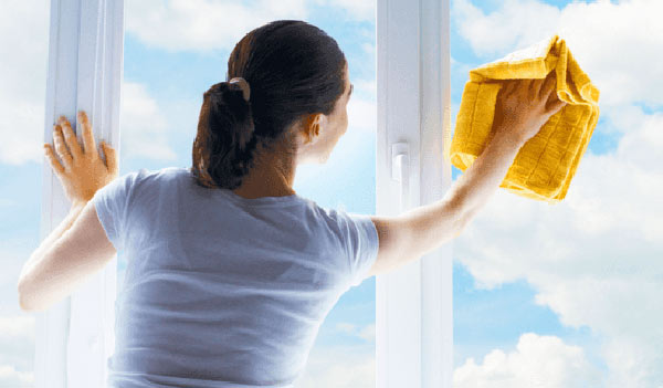 Woman cleaning the windows for Feng Shui Home