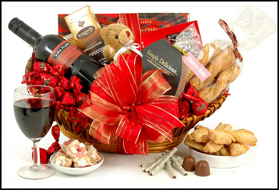 Anniversary gift hamper - Consist of wine, goodies, soft toys and chocolates
