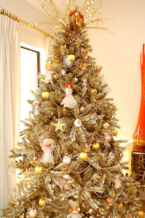 A Christmas tree with elegant and stunning Celestial Symbols of Angels