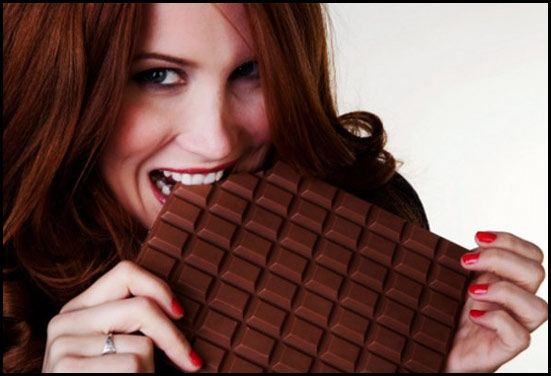 Girl eating chocolate - Importance of Chocolates are many