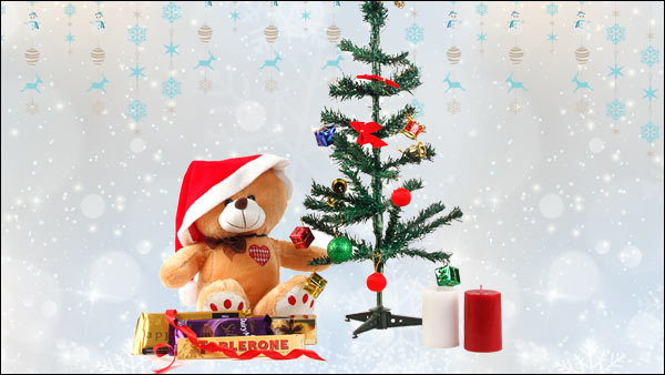 Ornamented Christmas Tree, Teddy Bear, Santa Cap, Toblerone, Cadbury Temptations, Cadbury Silk, 2 Aroma Candles