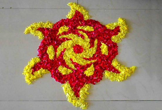 Rangoli design with Red and Yellow Flowers