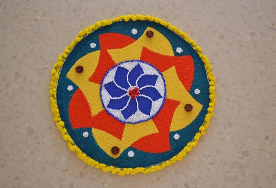 Diwali Rangoli Design with Flowers, Colours and Diyas