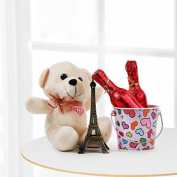 karwa Chauth Gift - A teddy with Eiffel tower and metallic basket with chocolate