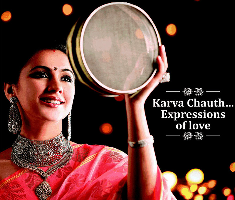 A Wife breaking fast of Karwa chauth by seeing through sieve