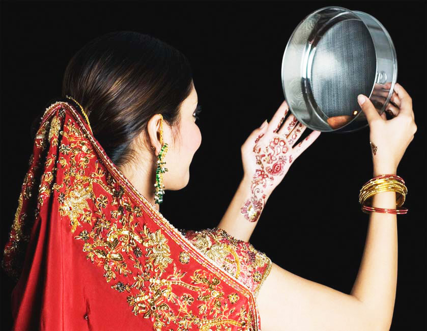 - A Wife smiling and seeing the moon A ritual of karwa chauth