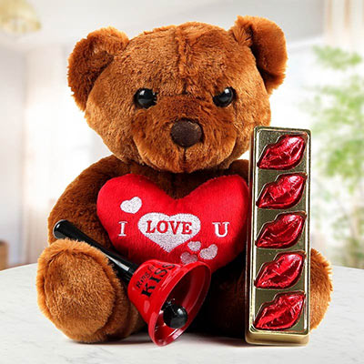 "A Brown Teddy With An ""I Love You"" Heart And Romantic Lip-Shaped Dark Chocolates"