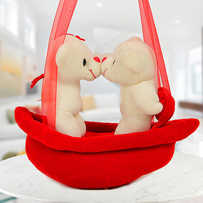 A Cuddly Cute Present Standing on a Red Swing