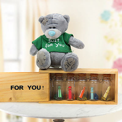 A Sweet Teddy With Love Notes And Letters
