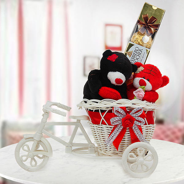 A beautiful teddy couple on miniature cycle