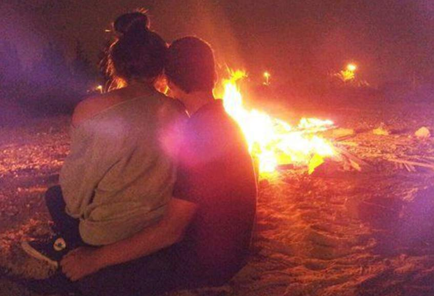 A Romantic Couple Enjoying Bonfire on Valentine Day
